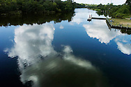 (PHOTO BY KEVIN BARTRAM).Clouds are reflected in the water of Dickinson Bayou near state Highway 3 in Dickinson, Texas on Tuesday, July 5, 2005.