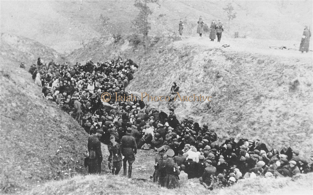 Einzatz Gruppen (death squads) gather to execute Jews in a pit or ditch, East Europe circa 1942