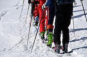 Line of backcountry skiers in Austria's Otztal Alps.