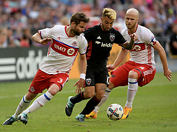 August 5, 2017 - Washington, DC, USA - 20170805 - D.C. United midfielder LUCIANO ACOSTA (10) breaks between Toronto FC defender DREW MOOR (3) and Toronto FC midfielder MICHAEL BRADLEY (4) in the first half at RFK Stadium in Washington. (Credit Image: © Chuck Myers via ZUMA Wire)
