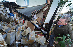 © Licensed to London News Pictures. 13/01/2015 Harrow, UK. A home owner surveys the damage to his garage in Harrow NW London after a  mini-tornado ripped apart the property in what firefighters described as 'like a scene from The Wizard of Oz' as Britain was on put on a snow and flood alert. Photo credit : Simon Jacobs/LNP