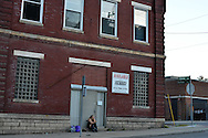 Sherry Sams, 41, a heroin addict, sits in front of a vacant building at State Street and Dutton Ave., where she works as a prostitute for drug money in the crime infested Lower Price Hills neighborhood in Cincinnati, Ohio. She started to do milder drugs and drinking at age 9, and heroin in 2003, and was raised in the neighborhood, one of the epicenters of a growing heroin crisis across the U.S.