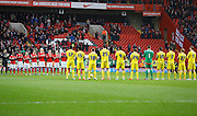 Both teams hold a minute of applause to remember those lost in 2015 before the Sky Bet Championship match between Charlton Athletic and Nottingham Forest at The Valley, London, England on 2 January 2016. Photo by Andy Walter.