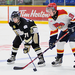 TRENTON, ON - Oct 26: Ontario Junior Hockey League game between Wellington Dukes and Trenton Golden Hawks. Brian Bunnett #18 of the Wellington Duke and Truman Landowski #71 of the Trenton Golden Hawks wait for the faceoff during first period game action..(Photo by Shawn Muir / OJHL Images)