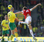 Picture by Paul Chesterton/Focus Images Ltd.  07904 640267.19/11/11.Laurent Koscielny of Arsenal and Steve Morison of Norwich in action during the Barclays Premier League match at Carrow Road stadium, Norwich.