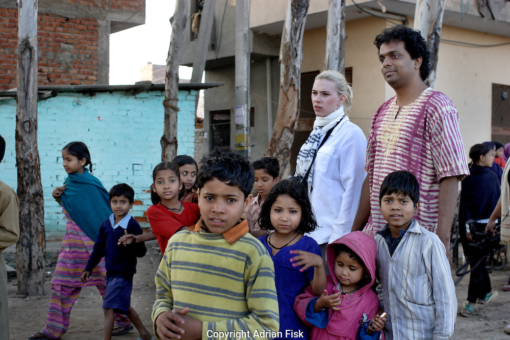Scarlett takes a walk with brother Steve in a slum rehabilitation colony on the outskirts of Delhi.