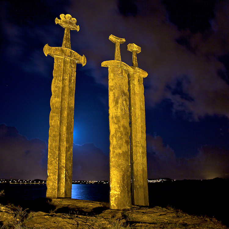 Three enormous bronze swords stand monument to the Battle of Hafrsfjord in the year 872, when Harald H&aring;rfagre (Fairheaded Harald) united Norway into one kingdom. The monument was designed by local artist Fritz R&oslash;ed and unveiled by Norway's King Olav in 1983.<br /> <br /> The swords, which are about 10 meters tall, stand for peace and unification. One sword is larger than the others. This was Fairheded Harald's sword. The crowns on the top of the swords represent the three districts that participated in the battle. The swords are planted in solid rock - representing peace. The monument is called Sverd i Fjell (Swords in Rock).