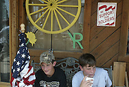 young Bush and Troops supporters in front of the Yellow Rose during a counter protest of the Cindy Sheehan Vigil