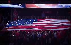 Dec 18, 2013; Newark, NJ, USA;  Fans hold an American Flag before the start of the game between the New Jersey Devils and the Ottawa Senators at the Prudential Center.