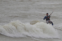 Chris Burns, Rugby Player with Seaford RFC kitesurfing on one very cold, wet and windy morning in Seaford