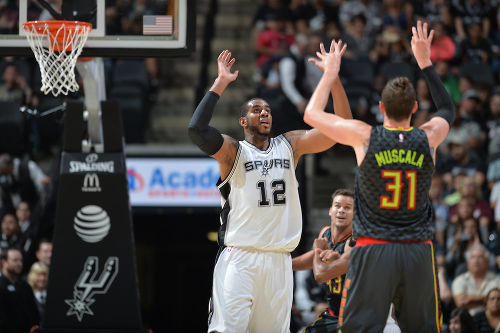 SAN ANTONIO TX - OCTOBER 8:   XXX of the San Antionio Spurs drives to the basket against the Atlanta Hawks on October 8 at the AT&T Center in San Antonio, Texas.  NOTE TO USER: User expressly acknowledges and agrees that, by downloading and or using this photograph, User is consenting to the terms and conditions of the Getty Images License Agreement. Mandatory Copyright Notice: Copyright 2016 NBAE (Photo by Mark Sobhani/NBAE via Getty Images)