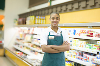 Teenage supermarket employee