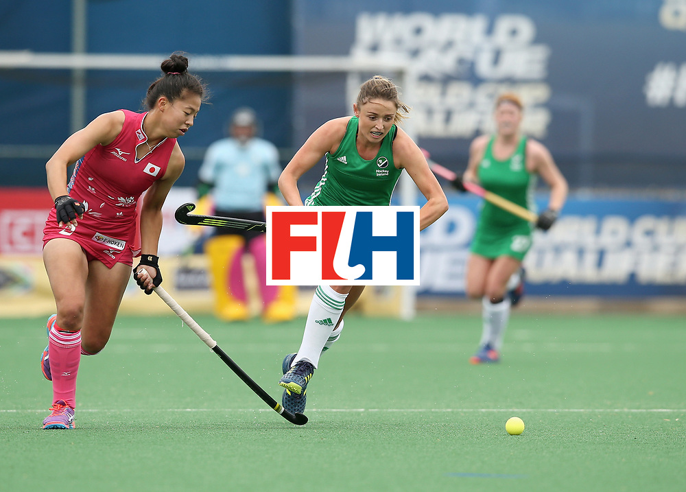 JOHANNESBURG, SOUTH AFRICA - JULY 08:  Gillian Pinder of Ireland is put under pressure by Yu Asai of Japan during the pool A match between Japan and Ireland on day one of the FIH Hockey World League Semi-Final at Wits University on July 8, 2017 in Johannesburg, South Africa.  (Photo by Jan Kruger/Getty Images for FIH)
