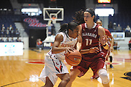 """Mississippi Lady Rebels guard Erika Sisk (5) drives against Alabama Crimson Tide guard Hannah Cook (11) at the C.M. """"Tad"""" Smith Coliseum in Oxford, Miss. on Sunday, January 11, 2015. (AP Photo/Oxford Eagle, Bruce Newman)"""