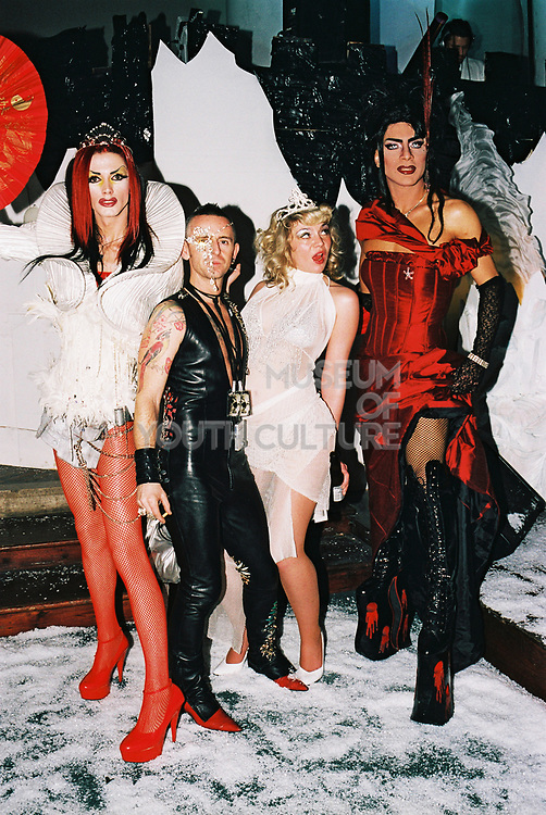 A couple pose with two transvestite at Return to Narnia, Pushca, New Years Eve, 2004