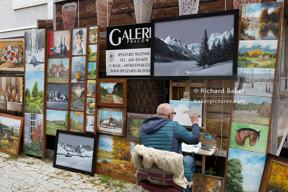 A local artist of Polish landscapes, animals and portraits, displayed on Krupowki Street, on 16th September 2019, in Zakopane, Malopolska, Poland.