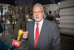 © Licensed to London News Pictures. 11/12/2017. London, UK. Vijay Mallya arrives at Westminster Magistrates Court this morning to attend a full extradition hearing as he is wanted to face allegations of fraud in India. Mallya is the chairman United Breweries Group and also co-owner of the Force India F1 team. Photo credit : Tom Nicholson/LNP