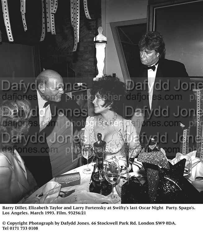 Barry Diller, Elizabeth Taylor and Larry Fortensky at Swifty's last Oscar Night  Party. Spago's. Los Angeles. March 1993. Film. 93256/21<br /> © Copyright Photograph by Dafydd Jones<br /> 66 Stockwell Park Rd. London SW9 0DA<br /> Tel 0171 733 0108