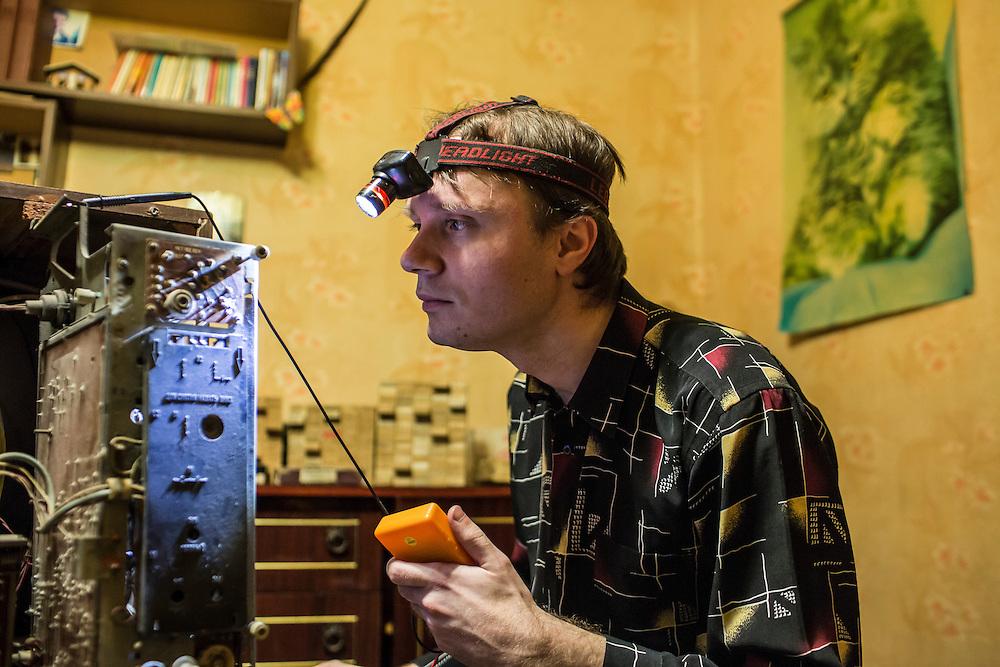 LUHANSK, UKRAINE - MARCH 15, 2015: Aleksandr Kryukov repairs an old Soviet television in Luhansk, Ukraine. CREDIT: Brendan Hoffman for The New York Times