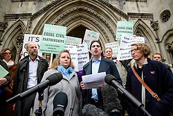 © Licensed to London News Pictures. 21/02/2017. London, UK. Heterosexual couple REBECCA STEINFELD and CHARLES KEIDAN (centre) leave the Royal Courts of Justice in London, where a Court of appeal ruled against the heterosexual couple being allowed to enter in to a civil partnership. Photo credit: Ben Cawthra/LNP