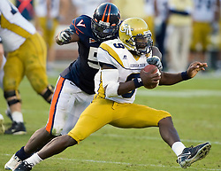 Virginia linebacker Clint Sintim (51) wraps up Georgia Tech quarterback Josh Nesbitt (9).  The Virginia Cavaliers defeated the #18 ranked Georgia Tech Yellow Jackets 24-17 in NCAA Division 1 Football at Bobby Dodd Stadium on the campus of Georgia Tech in Atlanta, GA on October 25, 2008.