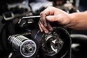 April 22-24, 2016: NHRA 4 Wide Nationals: NHRA mechanic works on a Top Fuel engine