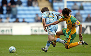 Coventry - Saturday, March 8th, 2008: Jay Tabb of Coventry City tries to get away as  Darel Russell of Norwich City launches himself at the Coventry player. Russell received a 2nd yellow card for this challenge during the Coca Cola Championship match at the Ricoh Arena, Coventry. (Pic by Paul Hollands/Focus Images)
