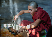 Buddhist Monk at Kha Khat Wain Kyaung Monastery Kitchen (Bago, Myanmar)