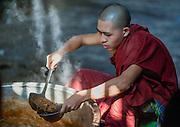 Buddhist Monk at Kha Khat Wain Kyaung Monastery Kitchen (Bago, Myanmar)