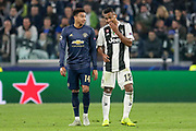 Manchester United Midfielder Jesse Lingard and Juventus Defender Alex Sandro share a laugh joke during the Champions League Group H match between Juventus FC and Manchester United at the Allianz Stadium, Turin, Italy on 7 November 2018.