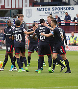 27th August 2017, Dens Park, Dundee, Dundee; Scottish Premier League football, Dundee versus Hibernian; Dundee's Kevin Holt is congratulated after scoring to put his team 1-0 ahead from the penalty spot