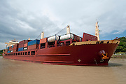 Containers cargo ship navigating on waters of the Panama Canal. Panama , Central America