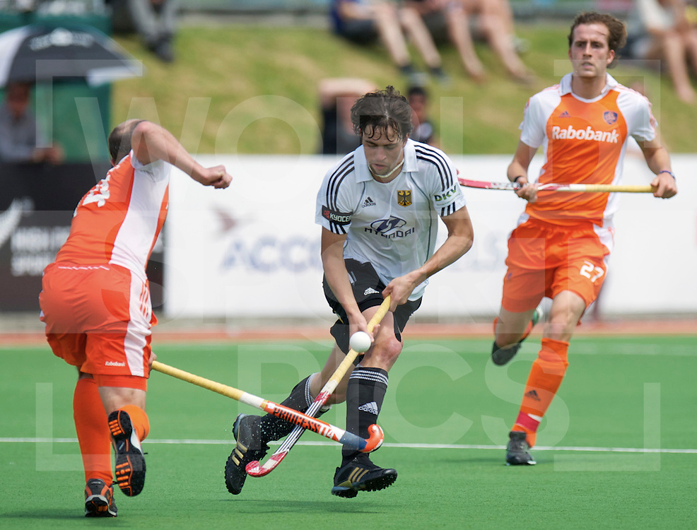 Jan Marco Montag pick the bal Netherlands Teun de Nooijer.,  during their Champions Trophy hockey match Netherlands against Germany  in Auckland, New Zealand, 01.12.2011. Foto: Frank Uijlenbroek