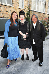 Left to right, LYNNE FRANKS, Designer JOHN ROCHA and his wife ODETTE at a dinner hosted by Harper's Bazaar to celebrate Browns 40th Anniversary in aid of Women International held at The Regent Penthouses & Lofts, 16-18 Marshall Street, London on 20th May 2010.