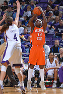 Oklahoma State forward Rashidat Sadiq (13) shoots a three pointer over Kansas State forward Ashley Sweat (4), during first half action at Bramlage Coliseum in Manhattan, Kansas, February 28, 2007.  Oklahoma State beat K-State 64-55.