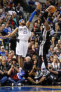 Dallas Mavericks shooting guard Vince Carter (25) tries to block San Antonio Spurs small forward Stephen Jackson (3) jump shot in the first half at American Airlines Center in Dallas, Texas, on January 25, 2013.  (Stan Olszewski/The Dallas Morning News)