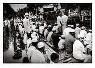 Muslim worshippers overflow onto Mumbai street as they pray for peace to commemorate the Mumbai train bombings are believed to be perpetuated by an extremist Muslim group.  One month earlier, terrorists (probably affiliated to a Kashmiri group, Lashkar e Toiba, LeT) planted bombs on commuter trains which exploded almost simultaneously at rush hour killing over 200 and wounding 700.
