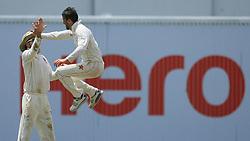 July 15, 2017 - Colombo, Sri Lanka - Zimbabwe's cricket captain Graeme Cremer, right, celebrates the dismissal of Sri Lanka's Kusal Mendis, (unseen), during the 2nd day's play of the only test cricket match between Sri Lanka and Zimbabwe in Colombo, Sri Lanka, Saturday, July 15, 2017. (Credit Image: © Tharaka Basnayaka/NurPhoto via ZUMA Press)