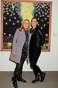 """Melissa Etheridge poses for a photo with her partner Linda Wallem, creator of Showtimes series Nurse Jackie at NMWA in front of one of Melissa's favorite paintings by Hollis Sigler called """"To Kiss The Spirits"""" at the National Museum of Women in the Arts in Washington DC. Sunday Nov. 4th. Grammy award winner Melissa Etheridge was presented with The Excellence in the  Performing Arts award from the National Museum of Women in the Arts (NMWA). Etheridge  also performed on the piano and then an acoustic set on guitar for an intimate audience of about 400 people. Photo ©Suzi Altman/For NMWA Grammy award winner Melissa Etheridge is presented with the National Museum of Women in the Arts' (NMWA) Award for Excellence in the Performing Arts in Washington DC. Sunday Nov. 4, 2012. Etheridge also performed on the piano and then an acoustic set on guitar for an intimate audience of about 300 people. Photo ©Suzi Altman/For NMWA<br /> <br /> Melissa Etheridge NMWA Award for Excellence in the Performing Arts"""