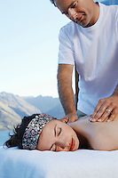 Woman getting a massage with mountains in background