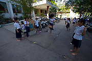 Children having fun rope jumping during a school break.