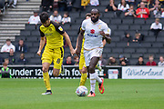 Hiram Boateng (26) is chased by Alex Gilbey (8)during the EFL Sky Bet League 1 match between Milton Keynes Dons and Burton Albion at stadium:mk, Milton Keynes, England on 5 October 2019.