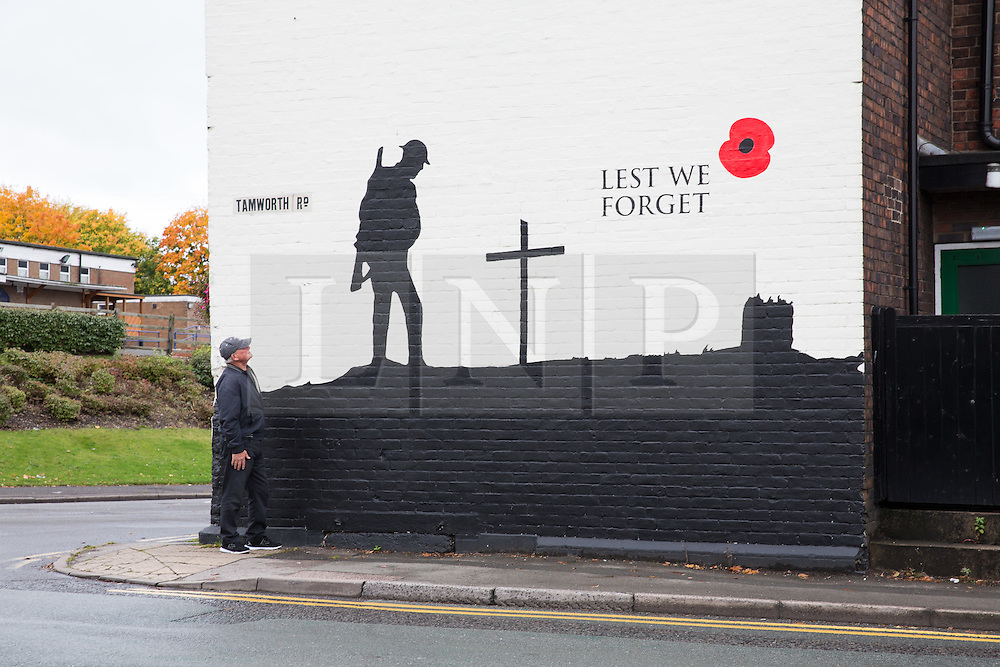 """© Licensed to London News Pictures. 21/10/2015.Tamworth, Staffordshire, UK. A remembrance mural that has just been painted on the outside of the """"Bulls Head"""" Public House on the A5 at Two gates in Tamworth, Staffs. The mural has created a lot of interest from passing traffic and passers by. Photo credit : Dave Warren/LNP"""