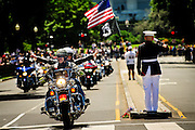 """For the 11th consecutive year, former United States Marine Tim Chambers holds a salute to honor fallen veterans as hundreds of thousands of motorcycle riders participate in Rolling Thunder's annual Memorial Day weekend """"Ride To The Wall"""", converging on the Vietnam Veterans Memorial in Washington, DC, USA on 26 May, 2013. Rolling Thunder Inc. is a non-profit organization dedicated to the search of American soldiers who are prisoners of war or missing in action. Rolling Thunder was established in 1987."""