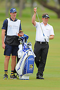 Luke Donald and his caddie during the first round of the World Golf Championship Cadillac Championship on the TPC Blue Monster Course at Doral Golf Resort And Spa on March 8, 2012 in Doral, Fla. ..©2012 Scott A. Miller.