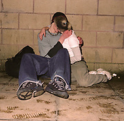 Couple kissing on the pavement, Cardiff 2000's
