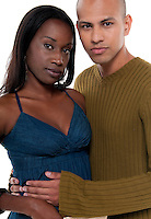 Young multiracial couple embracing with love isolated.