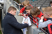MK Dons manager Karl Robinson signs a young fans shirt during the Sky Bet Championship match between Milton Keynes Dons and Brentford at stadium:mk, Milton Keynes, England on 23 April 2016. Photo by Dennis Goodwin.