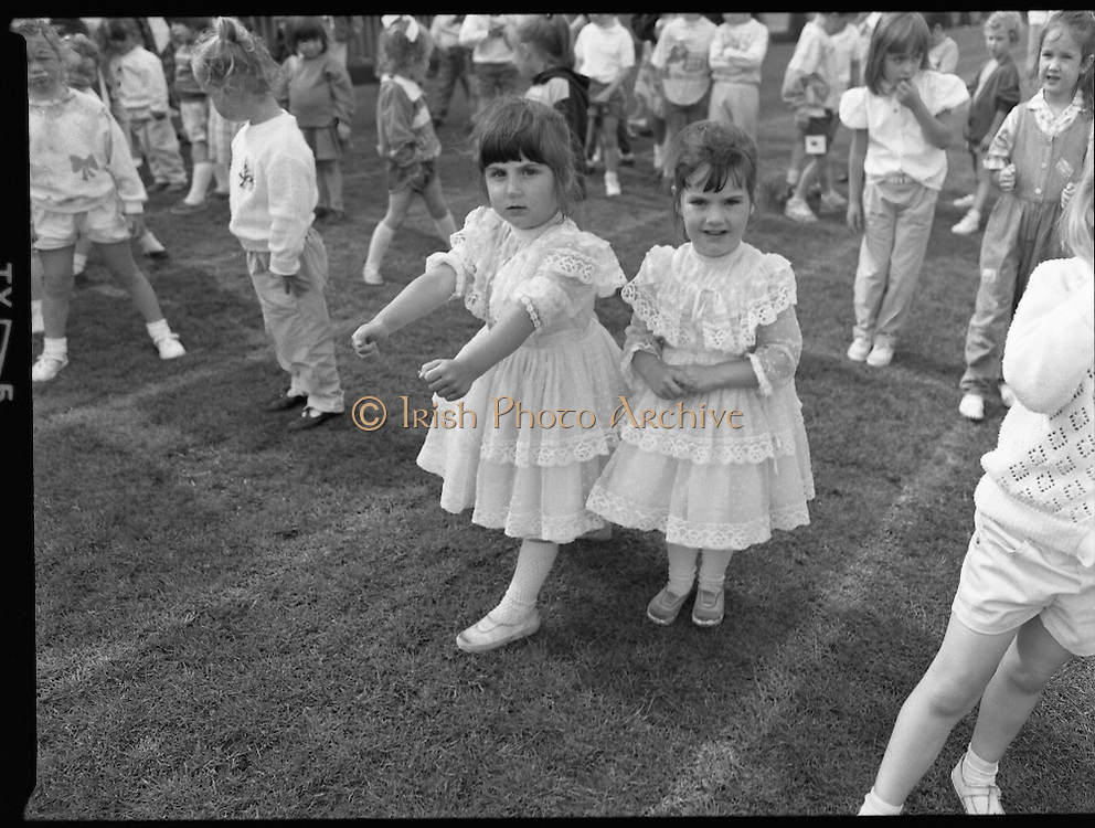 "Guinness Family Day At The Iveagh Gardens. (R83)..1988..02.07.1988..07.02.1988..2nd  July 1988..The family fun day for Guinness employees and their families took place at the Iveagh Gardens today. Top at the bill at the event were ""The Dubliners"" who treated the crowd to a performance of all their hits. Ireland's penalty hero from Euro 88, Packie Bonner, was on hand to sign autographs for the fans...With the rain gone the tots and toddlers races got underway. The children are pictured at the start line."