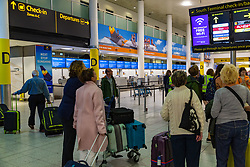 Passengers look for directions outside the deserted check in for travel company Thomas Cook, which has ceased trading after failing to come to a deal with its bankers and creditors, leaving tens of thousands of travellers unable to depart on their holidays from South Terminal at Gatwick Airport, and a massive repatriation exercise to return holidaymakers from destinations all over the world. London Gatwick Airport, September 23 2019.